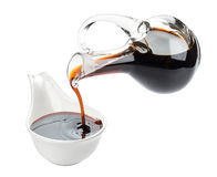 Soy sauce on white. Soy sauce and chopsticks isolated on white background, with clipping path Stock Photos