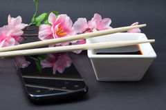 Soy sauce in a white dish and chopsticks Stock Photography