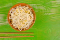Soy sprouts and chopsticks Royalty Free Stock Photos