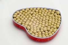 Soya bean. In heart-shaped container Royalty Free Stock Photography
