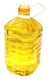 Soya bean oil. In a container over white background royalty free stock photos