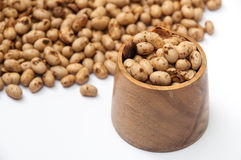 Soya beans in a wooden pot Royalty Free Stock Images
