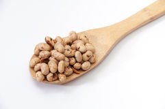 Soya beans on wooden spoon Stock Photography