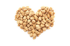 Soya protein chunks in a heart shape Royalty Free Stock Photos
