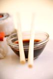 Soya sauce and chopsticks Royalty Free Stock Photos