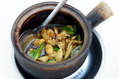 Soya sauce frog legs. Claypot frog legs cooked with green onion, ginger and black soy sauce Stock Image