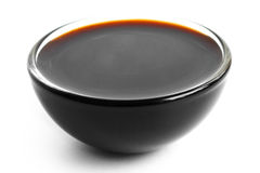 Soya sauce in small glass dish.  on white Stock Images