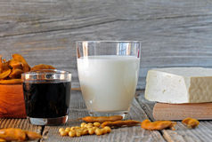 Soybean milk, sauce and tofu on a wooden table Stock Image