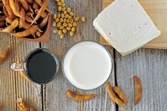 Soybean milk, sauce and tofu on a wooden table Royalty Free Stock Image