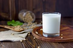 Soybean milk with soy beans around it.  Stock Photos