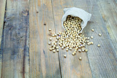 Soybean in sack on vintage wooden boards Stock Photography