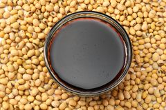 Soybeans background with soy souce in glass bowl. top view royalty free stock photography