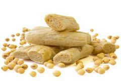 Soybeans and Beancurd sticks. Soybeans and Beancurd sticks on white background Stock Image