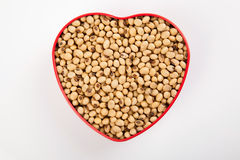 Soybeans in heart shape box Royalty Free Stock Photos