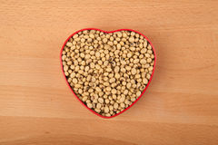 Soybeans in heart shape box Stock Images