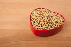 Soybeans in heart shape box Royalty Free Stock Photography
