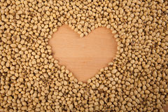 Soybeans with heart shape Royalty Free Stock Photos