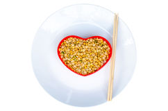 Soybeans in a heart shaped container red Stock Photos