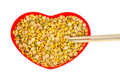 Soybeans in a heart shaped container red Royalty Free Stock Photography