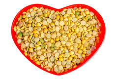 Soybeans in a heart shaped container red Stock Images