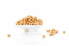 Soybeans i bunke. Arkivfoto