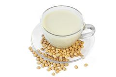 Soybeans and soy milk . Royalty Free Stock Images