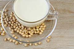 Soybeans and Soy milk on wooden background, healthy food. Royalty Free Stock Images