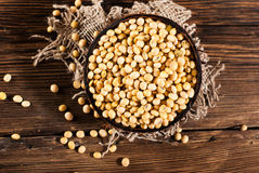 Soybeans on a wooden background. Royalty Free Stock Photos