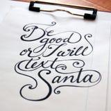 Soyez bon ou je textoterai le fond calligraphique de Santa image stock