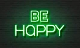 Soyez enseigne au néon heureux sur le fond de mur de briques Photo libre de droits