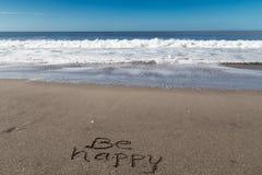 Soyez heureux en sable Photographie stock