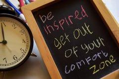 Soyez inspiré sortent de votre zone de confort photographie stock