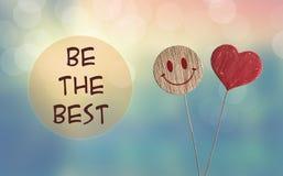 Soyez le meilleur avec l'emoji de coeur et de sourire images stock
