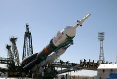 Soyuz Rocket Erection on the Launch Tower. Soyuz rocket is being erected on the launch tower on the 13th of June, 2010, at Baikonur cosmodrome in Kazakhstan to Stock Images