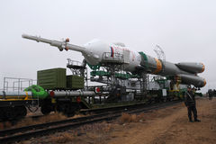 Soyuz TMA-21. BAIKONUR, KAZAKHSTAN - 02 APRIL: Soyuz TMA-21 is being transported to the launch pad along the railroad tracks at the cosmodrome at a early hour Royalty Free Stock Photos