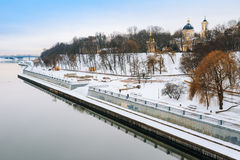 Sozh river embankment near the Palace and Park Ensemble in Gomel. Belarus. Peter and Paul Cathedral. Winter season Royalty Free Stock Photo