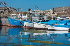 Fishing boats at the seaport are at the pier. Royalty Free Stock Photography