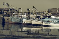 Fishing boats at the seaport are at the pier. Royalty Free Stock Photo