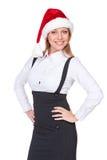 Spännande affärskvinna i den santa hatten Fotografering för Bildbyråer
