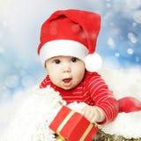 Spädbarn för jul eller för lyckligt nytt år Arkivfoto