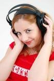 spännande flickahörlurar med mikrofon Fotografering för Bildbyråer