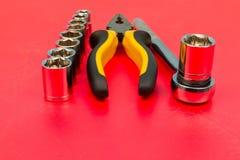 Spärrhjul och en uppsättning av utbytbara huvud Arkivfoton