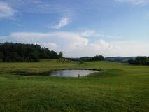 Später Nachmittag am Golfplatz Stockfotos