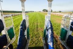 Spår för port för hästkapplöpninginsidastart Fotografering för Bildbyråer