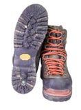 Spåring av de gamla bruna läderkängorna Arkivfoto