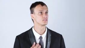 Spęczenie, zmieszany, sfrustowany młody biznesowy mężczyzna, fotografia stock