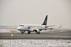 SP-LDK plane. This is a view of PLL LOT airline plane Embraer ERJ 170 Star Alliance registered as SP-LDK. December 31, 2014. Warsaw Chopin Airport in Warsaw Royalty Free Stock Image