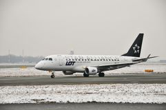 SP-LDK plane. This is a view of PLL LOT airline plane Embraer ERJ 170 Star Alliance registered as SP-LDK. December 31, 2014. Warsaw Chopin Airport in Warsaw Stock Photography