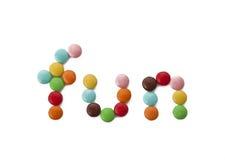 Spaß mit mehrfarbiger Süßigkeit - eine reale Party Stockbild