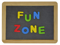 Spaß-Zone in farbigen Buchstaben auf Schiefer Stockfotos
